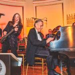 """Honored as a """"Living Landmark"""" himself, Peter plays with guitarist and vocalist Roberta Fabiano at a New York Landmarks Conservancy ceremony"""